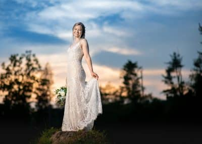 Bride on tree stump at Cove Haven