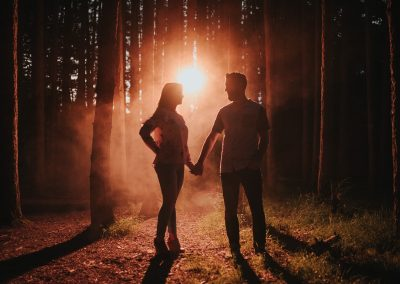 Couple in forest with red fog