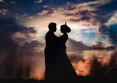 couple in the sky with sunset